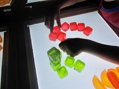 sorting, stacking and lining up plastic ice cubes on the light table