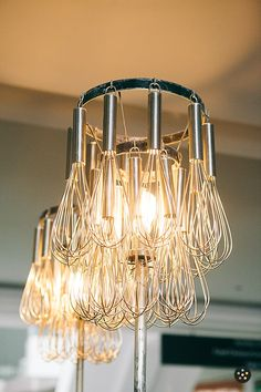 This takes the hanging votive to a whole other level – here's a whisk chandelier! Fun kitsch DIY with kitchen utensils.