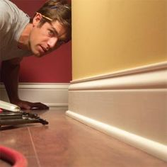 How to Install Baseboard Molding, Even on Crooked Walls you can get perfectly tight joints and smooth, clean, professional results when installing trim, even on bad walls. this article demonstrates se Baseboard Molding, Base Moulding, Moldings And Trim, Wall Molding, Wainscoting, Crown Moldings, Floor Molding, Baseboard Ideas, Baseboard Styles