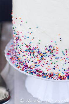 Sprinkles only scattered on the bottom. Cute birthday cake