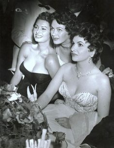 Sophia Loren, Yvonne de Carlo, and Gina Lollobrigida at a Berlin International Film Festival ball in 1954.