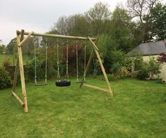 A beautiful timber frame nestling in a gorgeous garden . Change the swing seats to your needs. This one has two deluxe seats and one horizontal tyre . Hours of outdoor fun Wooden Swing Frame, Wooden Climbing Frame, Wooden Swings, Tire Garden, Wooden Garden, Backyard Play, Backyard For Kids, Tire Seats, Tree Deck