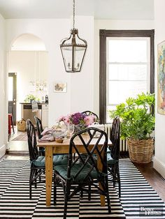 BHG-Design aspects such as the striped rug and sleek black Chippendale chairs play off a humble wood farm table in the room | City Farmhouse