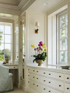I love this idea equally well for both home offices and closets- big, beautiful windows are the center of attention when fitted with built-ins and desk space.  Keeping the palette clean and neutral feels serene and clean!