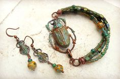 July 2015 challenge entry - multi strand bracelet and matching earrings made with brass beetles from B'Sue Boutiques.