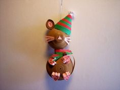 A little brown mouse is all bundled up with a tasseled hat and a fringed scarf. He has a little pink nose and whiskers and little pink feet, sooooo