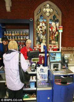 Tills ringing, not bells: A worker hands over change to a customer