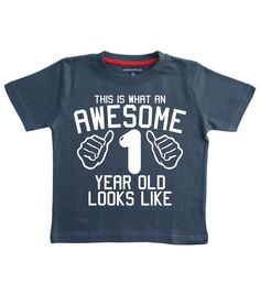 "Personalised ""THIS WHAT AN AWESOME 1 YEAR OLD LOOKS LIKE"" With Your Name On The Back! - Size 1-2 Years Washed Navy Boy's 1st Birthday T-shirt With A White Print."
