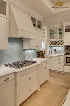 We love this light blue that wraps around this kitchen! Kitchen Decor, Kitchen Design, Blue Backsplash, New Home Construction, Custom Kitchens, Interior Decorating, Interior Design, Home Trends, Kitchen Trends