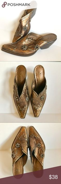 BCBG Western or Steampunk Slip-ons Unique design slip on heels with a traditional cowboy boot shape. They have amazing cut out designs along with leather beaded embellishments through out. They have this steampunk feel to them for sure. Size 8. The color is copper and golden. Thank you for looking and please check out the rest of my closet. BCBGirls Shoes