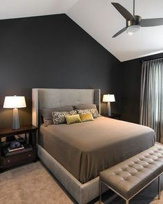 Sleek, masculine master bedroom with a modern ceiling fan by Room Service Interior Design