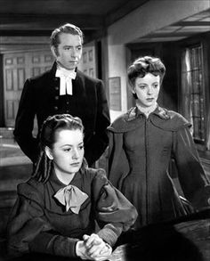Olivia De Havilland, Paul Henried and Ida Lupino in Devotion 1946