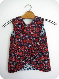 DIY reversible girls dress with cross over back!  this is kind of similar to the baby apron dresses I told you about