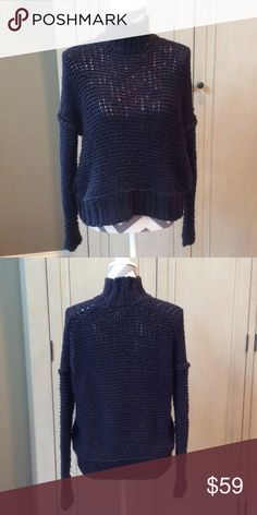 Cozy Free People Navy Sweater Comfy and soft Free People sweater. Navy loose knit with drop shoulder and mock neck. Worn once. Free People Sweaters