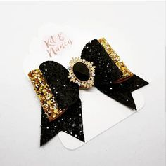 Deluxe, bejewelled black & gold glitter hair bow, handmade in rural Lincolnshire. Available with a jewelled central embellishment, or simply left plain. They are made using high quality fabric which will not shed or fray, and are finished with a strong silver tone crocodile clip