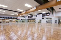Huge Group Exercise Room with Stained Hardwood Floors #EFC #Augusta