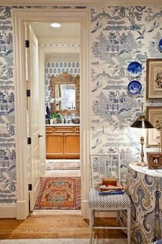 Eric Ross Interiors ~ Anthropologie Wallpaper ~ Such a dramatic room with the blue and white wallpaper that is shown with a coordinating wallpaper continued on to what appears to be the bathroom. The fabric used on the table coordinates beautifully. Chinoiserie Wallpaper, Of Wallpaper, Paisley Wallpaper, Bedroom Wallpaper, Interior Wallpaper, Chinese Wallpaper, Beautiful Wallpaper, Blue Rooms, White Rooms