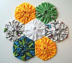 It's a yo-yo AND a hexagon!  Fabulous!