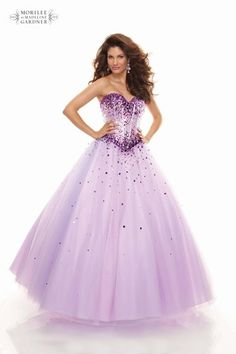 Feel like a princess in this Mori Lee gown - with a beaded bodice and full tulle skirt.