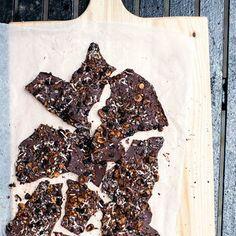 salted dark chocolate bark with hazelnuts, sesame seeds, coconut, currants + cacao nibs