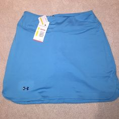 Under Armour golf or tennis skirt.  Blue small NWT Under armor NWT Blue golf or tennis skirt size medium semi fitted. Built-in shorts Under Armour Skirts