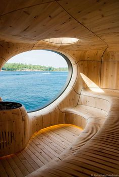 """Grotto Sauna by Partisans. """"Spreading over 800 square feet, this experimental sauna we stumbled upon rises from the rocks of a private island along the Georgian Bay in Canada. Designed by PARTISANS, the free-standing structure built by the lake was inspired by natural geography that also gives the name of this snug sauna. The modern Canadian prefab construction was created with customized help from a millwork and steel fabrication partner, ensuring details are sculpted to perfection."""""""
