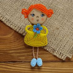 Brooch doll with a memorable face #jewelry #brooch #handmade #doll #girl #girlfriend #redhead #bead #OOAK