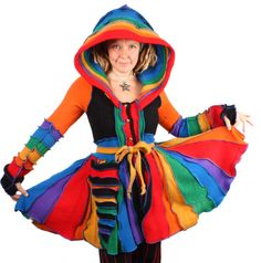 Azor Ahai is a classic Katwise rainbow coat made from the brightest and boldest wools. It features an extra-full twirly skirt and a golden button front.