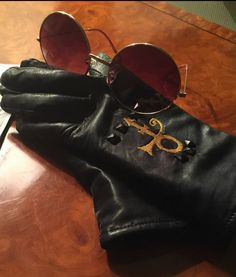 Prince's gloves and glasses, shared by TV host Tamron Hall. Mavis Staples, Sheila E, Purple Rain, Madonna, Tamron Hall, Paisley Park, Dearly Beloved, Thing 1, Roger Nelson