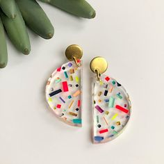 SPRING BREAK! Colorful hand painted clear acrylic geometric earrings. #modernjewelry #fashionjewelry #statementearrings