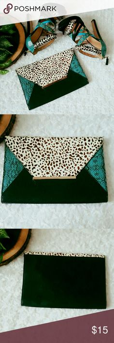 """Chic and Egdy Aldo Clutch Step out with this chic and edgy calf hair and faux leather Aldo clutch.   Flip closure Bottom width - appx. 10.5"""" Height- 7"""" Interior zip pocket w/clean lining Decorative metal ornament  EUC. Used once. Smoke and pet free home.   No Trades! Bundle and Save! Free thank you gift!  Inquire below with questions! Hit offer button with a reasonable offers. Never declined!   Thanks for looking, shopping, and saving! Aldo Bags Clutches & Wristlets"""