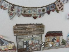 Reiko Kato applique wallhanging / quilt. Sweet shop and stable. Japanese / Folk style