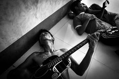 A man who had used heroin for seven years plays the guitar while singing with friends at the rehab camp. He died of unknown causes months after this photo was taken. (Photography by Pailin Wedel) American Video, Plays, Drugs, Ethnic, Singing, Guitar, China, Group, Mountains