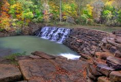 DEVIL'S DEN STATE PARK The Civilian Conservation Corp built this dam using native stone in the 1930's. It spans Lee Creek to create Lake Devil in the center of this beautiful Arkansas State Park.