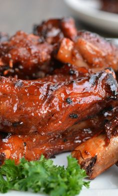 Finger lickin' barbecued Baby Back Ribs ~ They are the BEST... Tender, melt-in-your-mouth, fallin-off-the-bone ribs that are thickly caramelized with the perfect barbecue sauce