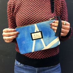 """Hand sewn zipper clutch made with hand-stained canvas on one side,  repurposed black leather on the other, and lined with vintage fabric  (liners vary, are always awesome, and are like a little secret just for  you). Black leather tassel pull on brass YKK zipper.  Measures apx 9.75"""" wide x"""