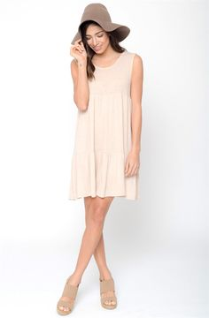 Cut in a swingy silhouette with allover seaming detail, a rounded neckline in just the right length. Featuring a ruffled hemline to bring in simple detail to your everyday look.
