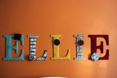 letters from hobby lobby wrapped in yarn for above a bed or crib by my dirty aprons blog.
