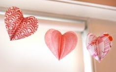 cut hearts of different sizes, fold in half, glue creases together to make 3D hearts . Double up and glue string between halves to create a heart banner - Mobiles Hearts