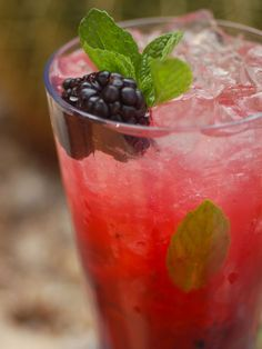When blackberries are ripe and in-season, nothing beats a Blackberry Mojito. Perrier adds a nice sparkle to this drink.  2 oz silver rum (i.e. Cruzan)  1 oz lime juice, fresh squeezed  1 oz simple syrup  4 blackberries (plus one extra, for garnish)  10-15 mint leaves  Mint sprig, for garnish  Blackberry, for garnish  1 oz Perrier  Directions: In a mixing glass, muddle blackberries and mint with lime juice and simple syrup. Add rum. Top with crushed ice. Add a splash of Perrier and stir well…