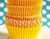 bright yellow cupcake liners for $3.60.  Yes, please!