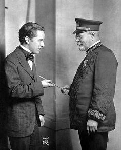 chaplinfortheages:  Composer John Philip Sousa, hands over his baton to Charlie Chaplin - 1916. Though 27 years old, Charlie Chaplin looks like a teenager.