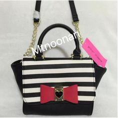 """Betsey Johnson Winged Trapeze CrossBody Satchel NEW WITH TAGS, Betsey Johnson Black and White Stripe Winged Trapeze Mini CrossBody Bow Satchel  • Color: Black/Off White (or Ivory) with Red faux leather bow • Measurements: 8""""-12""""L x 6.5""""H x 4""""D with 52"""" removable chain link strap • Handle drop: 4"""" • Interior: 1 slip pocket and 1 zipper compartment • Top magnetic snap flap closure • Pink signature satin lining • Gold tone hardware • MSRP $78.00   I have more BETSEY JOHNSON, check out my other…"""
