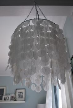faux capiz chandelier   oh wow!  The Sweetest Digs found a brilliant way to use an iron hanging basket to make this .. very clever!!!