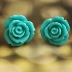 Always drawn to inexpensive jewelry. Adorable blue rose earrings.