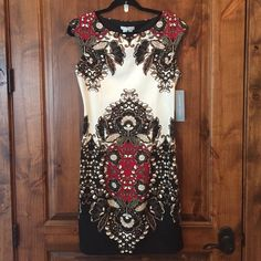 Nwt London Times floral dress **lowest price** A stunning floral shift dress. Brand new with tags. The fabric is super soft and the shape amazing.  Perfect for Sunday best or a day at the office. Knee length. Up close of print in finals pic. London Times Dresses