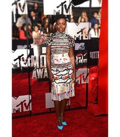 @Lupita_Nyongo at the 2014 #MTVMovieAwards wearing a printed dress from Fall-Winter 2014/15 Ready-to-Wear