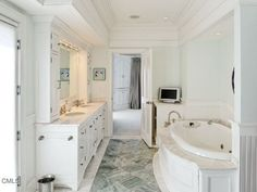 There is something so classic about an all white bathroom, this one is even greater because of its amenities like a soaking tub, stand alone shower, vanity, and double sink.  $4,895,000