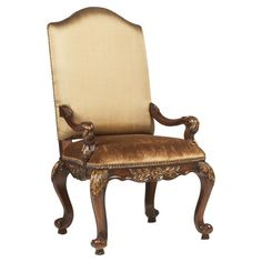 Add an ornate touch to your eat-in kitchen or dining room with this lovely arm chair, showcasing resin accents and nailhead trim.  P...