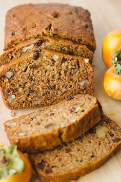 This Persimmon Bread Recipe is a keeper (in a make again and again sort of way)! Soft, moist, and every slice is studded with walnuts and raisins | natashaskitchen.com